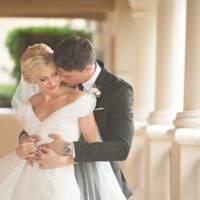 Groom kissing bride on the cheek - Palm Coast Wedding
