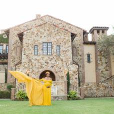 Deidra poses in flowy dress at Bella Collina